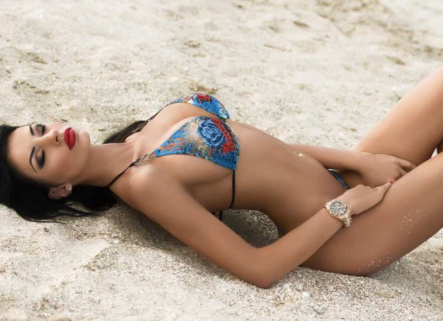 Pretty woman for marriage laying on the beach
