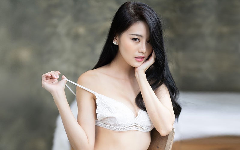 beautiful chinese woman in bedroom