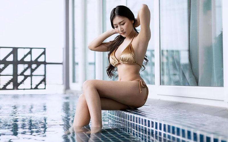pretty thai woman near swimming pool